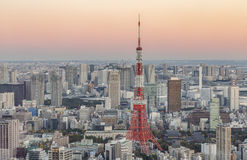 Tokyo Tower and nearby skyscrapers at sunset Royalty Free Stock Photos