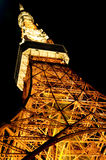 Tokyo Tower night scene. Low angle view of Tokyo Tower illuminated at night, Tokyo, Japan stock photos