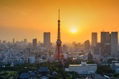 Tokyo tower at sunset, Japan. Tokyo, Japan - May 8, 2017: Tokyo tower architecture at sunset from World Trade Center building view. The observatory is famous to royalty free stock photos
