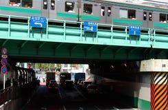 Tokyo Transportation. Train, cars, and pedestrians near Shinjuku station in Tokyo, Japan Royalty Free Stock Photos