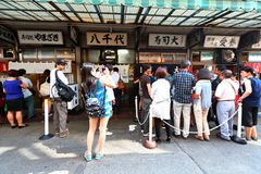 Tokyo: Tsukiji fish market. Large number of visitors waiting to dine at the sushi shops . These shops are found at the outer market area whose retail shops and royalty free stock photography