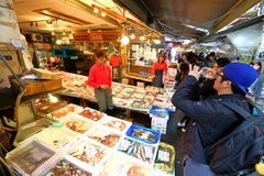 Tokyo: Tsukiji Seafood Fish Market. Workers selling fresh seafood at the Tsukiji Wholesale Seafood and Fish Market in Tokyo Japan. Locals and tourist visit the stock photography