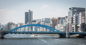 Tokyo Water Bus is cruising pass the bridge of Asakusa area. Tokyo, Japan - May 5, 2017: Tokyo Water Bus is cruising pass the bridge of Asakusa area Royalty Free Stock Photography