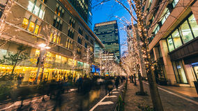 Tokyo Winter Illuminations. Tokyo, Japan - December 24, 2014:  Crowds enjoy the winter illuminations in the Marunouchi district of Tokyo on Christmas Eve when Royalty Free Stock Image