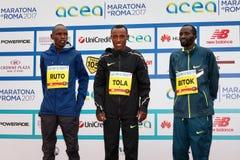 Tola, Ruto и Bitok, покрывают 3 в марафоне 2017 Рима Стоковое Фото