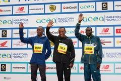 Tola, Ruto и Bitok, покрывают 3 в марафоне 2017 Рима Стоковая Фотография