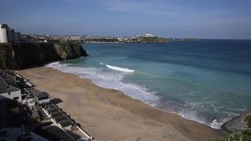 Tolcarne beach Newquay North Cornwall UK by Narrowcliffe in spring with blue sky and sea stock video footage