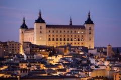 Toledo Alcazar bij Schemer Stock Afbeeldingen