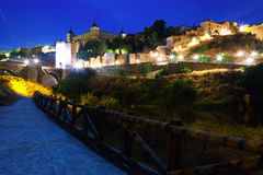 Toledo with Alcazar from river in night Stock Photos