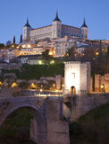 Toledo - Alcazar and Saint Martin bridge in morning Royalty Free Stock Images