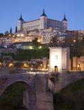 Toledo - Alcazar and Saint Martin bridge in morning Royalty Free Stock Images