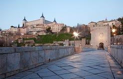 Toledo - Alcazar and Saint Martin bridge in morning Stock Images