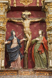 Toledo - Crucifixion baroque statue with hl. Mary and saint John from church Iglesia de san Idefonso Stock Images