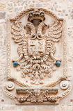Toledo - Eagle as heraldry of the town. On the town walls on March 8, 2013 in Toledo, Spain Royalty Free Stock Photos