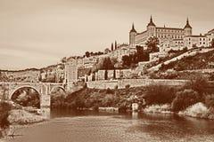 Toledo with fortress Alcazar, bridge de Alcantara and river Tajo, Spain Royalty Free Stock Photography