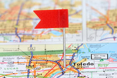 Toledo, OH. Io. Red flag pin on an old map showing travel destination stock photos