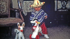 TOLEDO, OHIO 1968: Kid dressed as mexican bandit riding play horse, smoking cigar. stock video