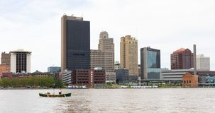 Toledo Ohio. Toledo, Ohio, USA - June 8, 2019: Tour Boat navigating the Maumee River looking at the city Skyline stock photo