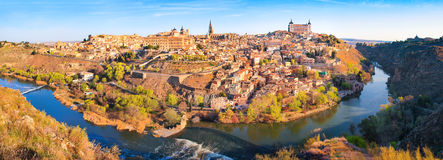 Toledo panorama in Castile-La Mancha, Spain. Panoramic view of the historic city of Toledo with river Tajo at sunset in Castile-La Mancha, Spain royalty free stock photo