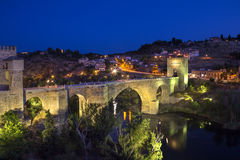 Toledo in Spain. Puente san Martin (Bridge of San Martin) over the River Tagus in the city of Toledo in the La Mancha region of central Spain Royalty Free Stock Images