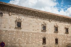 Architectural detail of the museum Santa Cruz de Toledo. Toledo, Spain - April 28, 2018: Architectural detail of the museum Santa Cruz de Toledo on a spring day stock photos
