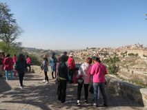 Asian tourists in Toledo. TOLEDO, SPAIN - CIRCA OCTOBER 2017: Asian tourists in Toledo staring at the town from the hill Stock Images