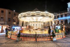 Toledo, Spain - December 14, 2018: Carousel and people enjoying christmas time in Toledo cathedral square.  stock photos