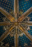 TOLEDO, SPAIN - FEBRUARY 8, 2017: A ceiling of the Primate Cathedral of Saint Mary of Toledo. Decorated with dragons` heads and stars, Castilla-La Mancha Royalty Free Stock Photo