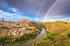 Toledo, Spain old town skyline. With a rainbow over the Tagus River royalty free stock photography
