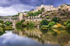 Toledo, Spain on the Tagus River. Toledo, Spain town skyline on the Tagus River Royalty Free Stock Photo
