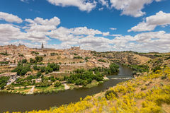 Toledo, beside the Tagus River, Spain. Toledo, Spain old town city skyline royalty free stock photo
