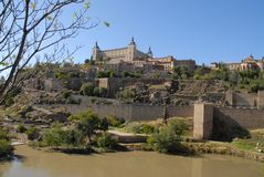 Toledo, viewed across the Tagus River on a beautiful sunny day royalty free stock image