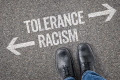 Tolerance or Racism. Decision at a crossroad - Tolerance or Racism Stock Image