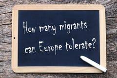 Tolerera, hur många migranter på burk Europa royaltyfria foton
