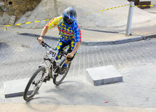 Toletvm Urban DH competition of mountain bike. TOLEDO, SPAIN - SEPTEMBER 9: Unidentified competitor during the  I Toletvm Urban DH competition on September 9 Royalty Free Stock Photo