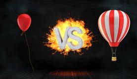 tolkning 3d av ett stort flammande ord VS ställningar mellan en röd partiballong och en randig ballong för varm luft med en korg Royaltyfri Fotografi