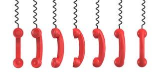tolkning 3d av flera röda retro telefonmottagare som hänger från deras svartkablar på en vit bakgrund Royaltyfri Bild