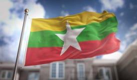 Tolkning för Myanmar flagga 3D på byggnadsbakgrund för blå himmel Arkivbilder