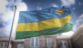 Tolkning för Rwanda flagga 3D på byggnadsbakgrund för blå himmel Arkivfoto