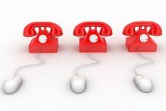 tolkningen 3D av en klassisk röd telefon förband till en datormus Royaltyfri Fotografi