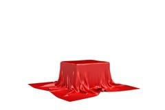 tolkningen 3d av ett stycke av röd satängkläder är rimlig att dölja en ask på vit bakgrund Royaltyfri Bild
