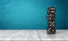 tolkningen 3d av fyra svarta tärning med vita prickar står på de i en kolonn på ett träskrivbord på en blå bakgrund Arkivfoto