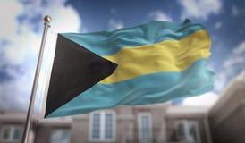 Tolkningen för Bahamas flagga 3D på byggnadsbakgrund för blå himmel Arkivbilder