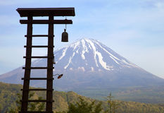 Toll Bell and Mount Fuji. Toll bell tower in the village of Saiko Iyashi no sato nenba near Mount Fuji stock photography