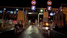 Toll gate on the highway in France in night stock footage