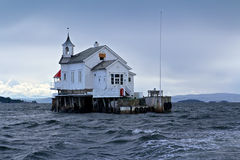 Toll house in stormy Sea Stock Photo