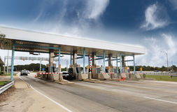 Toll Plaza. Highway toll plaza with light traffic and blue sky Royalty Free Stock Image
