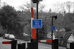 Toll road sign with barrier and price stock photo
