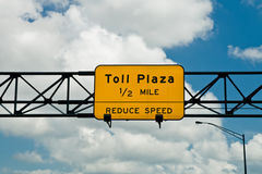 Toll Sign. Sign warning of approaching toll plaza Stock Photos