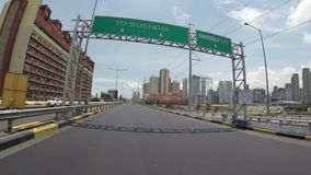 Vehicle shot cruising along elevated sky highway. Toll skyway, Manila, Philippines - July 11,2017: Vehicle shot cruising along elevated sky highway overtaking stock footage